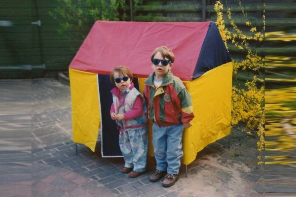 Me and my brother in front of our first tiny house