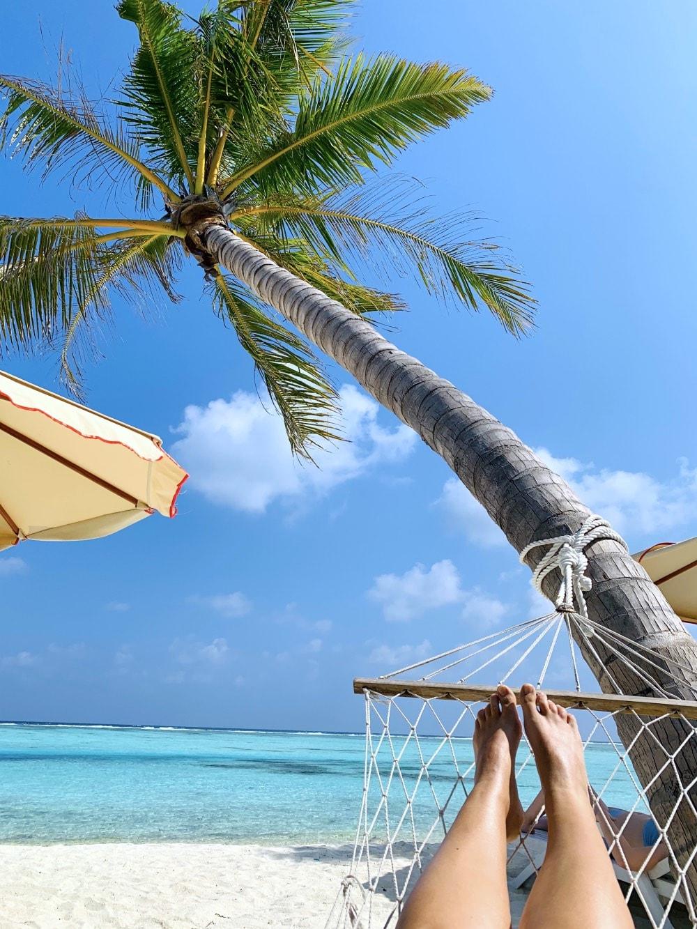 Dhiffushi maldives hammock beach sea paradise