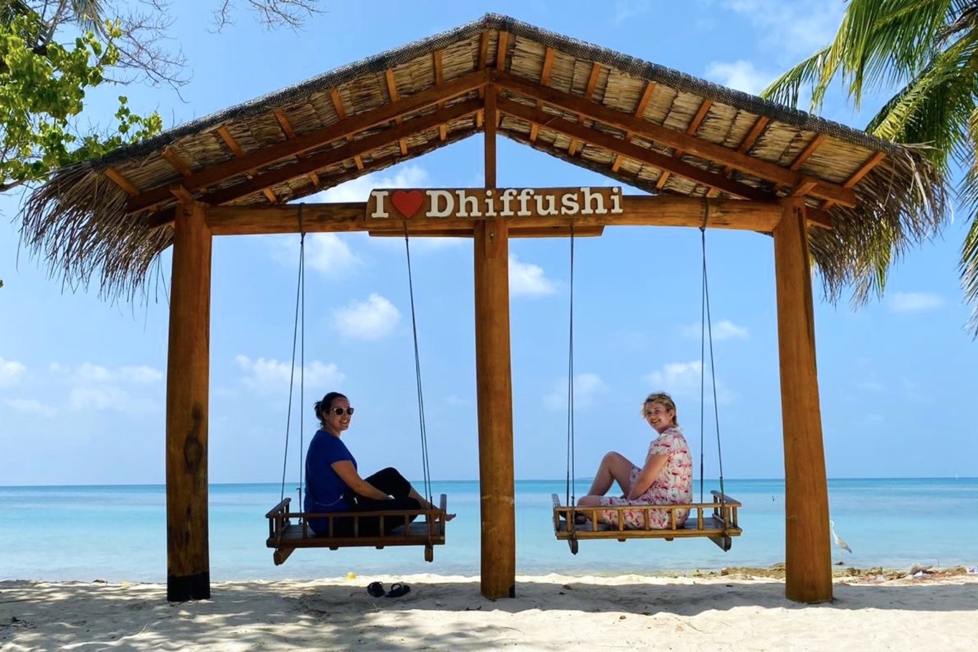 Dhiffushi maldives swing beach sea