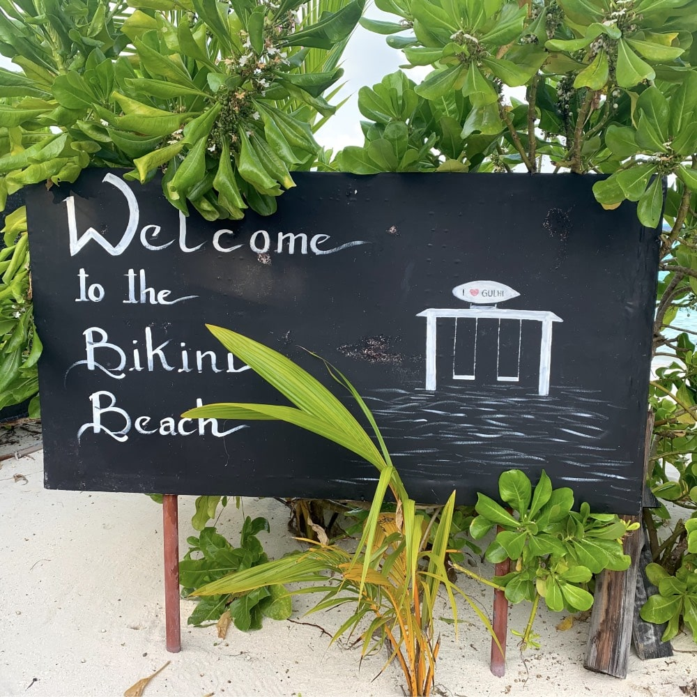 gulhi bikini beach sign island maldives